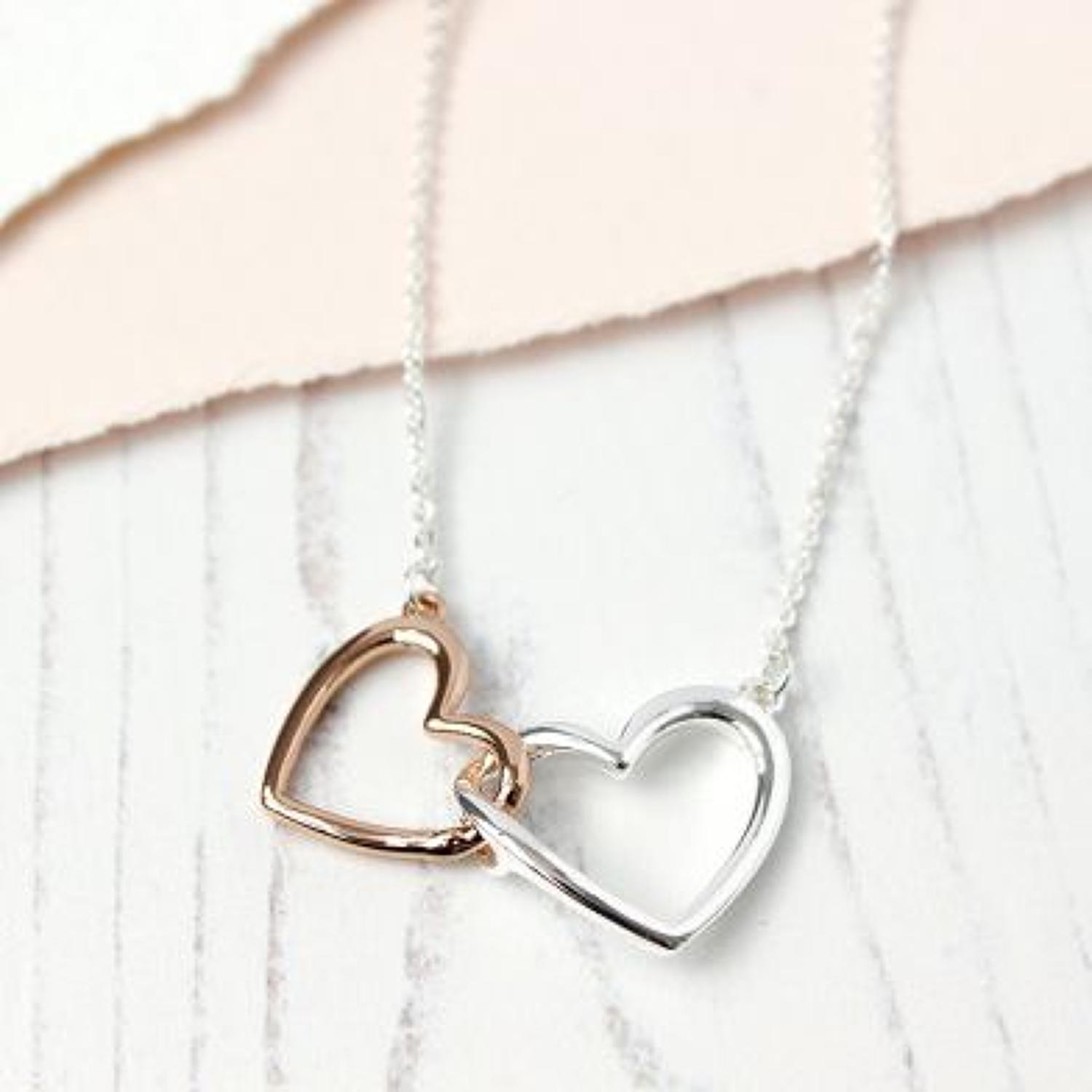 Silver rose gold linked hearts necklace
