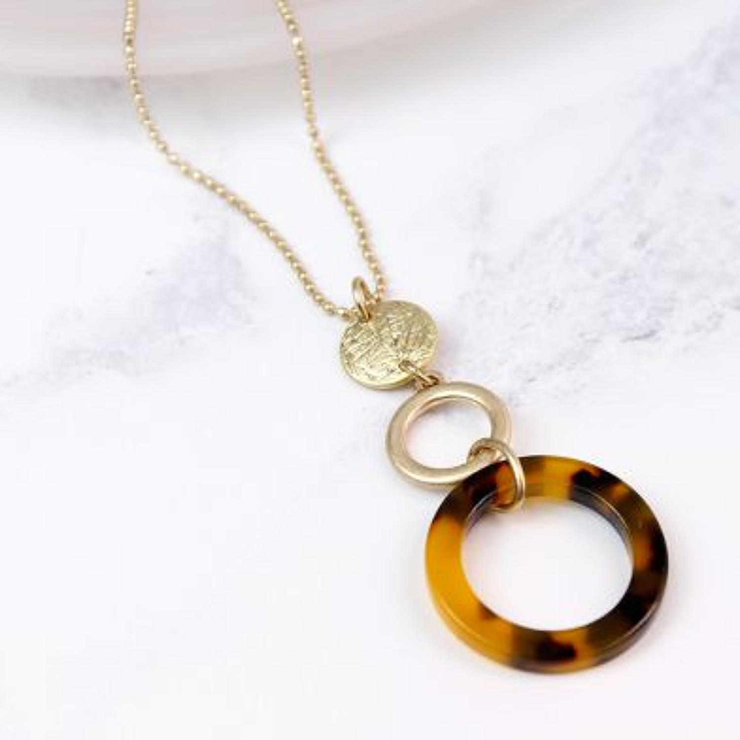 POM - Worn gold disc/tortoise shell necklace