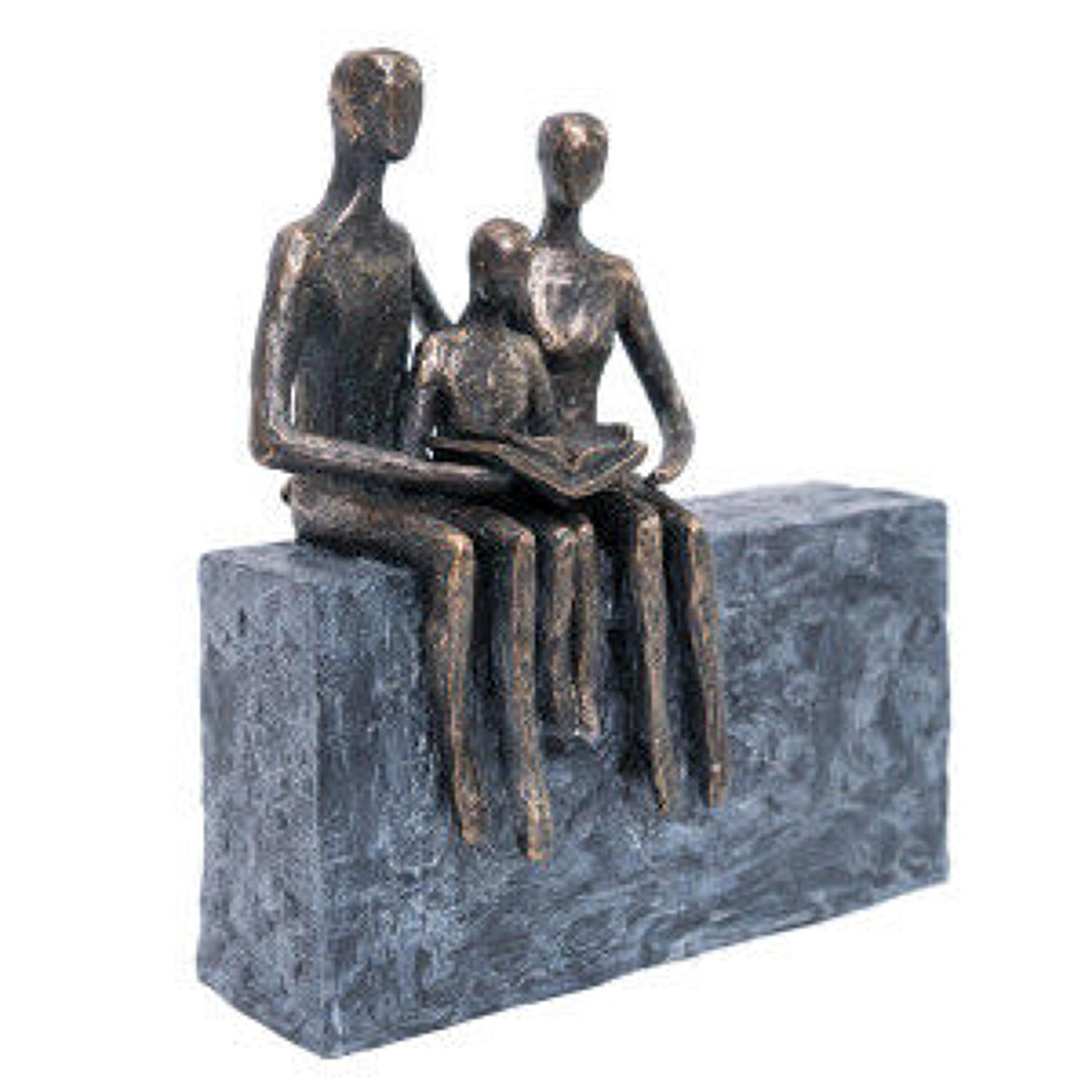 Family reading sculpture