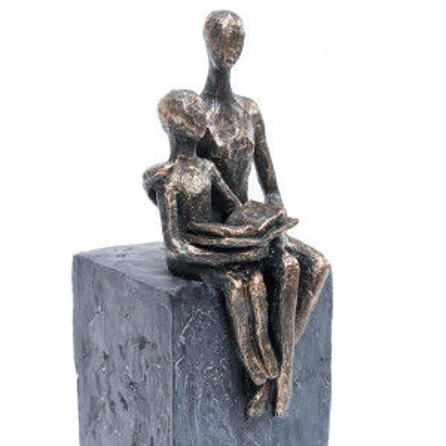 Mother and child reading sculpture