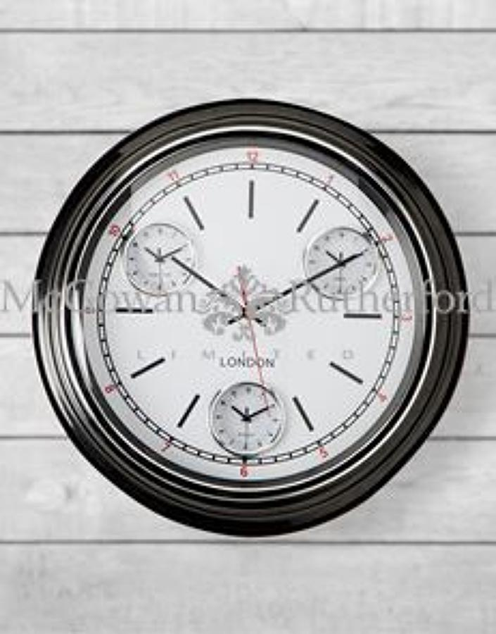 Black framed multi dial curved glass retro wall clock