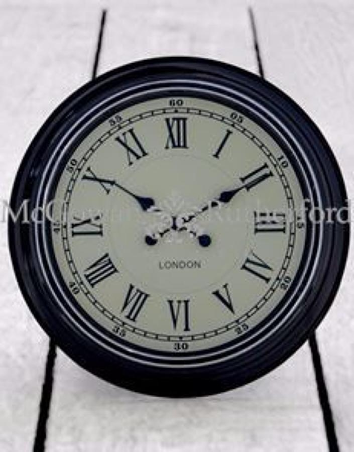 Modern black with white face wall clock