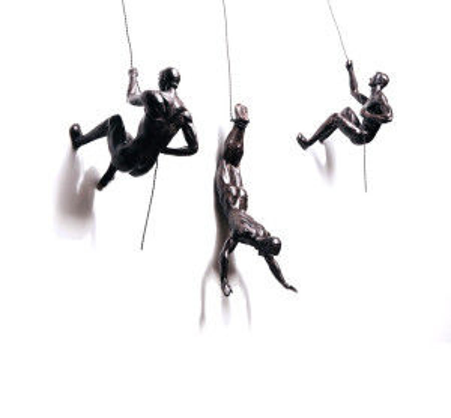Bronze climbing men trio