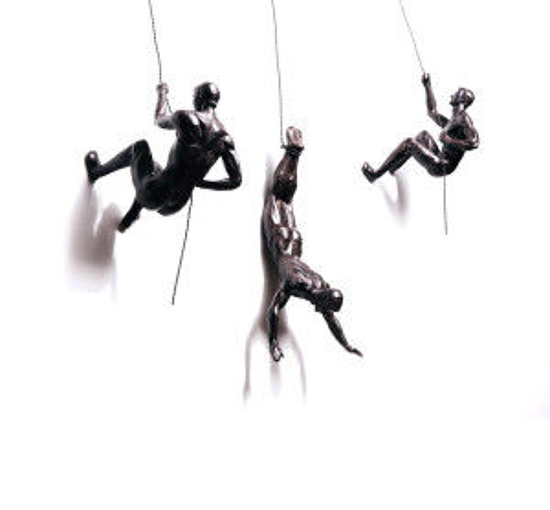 Bronze climbing men trio